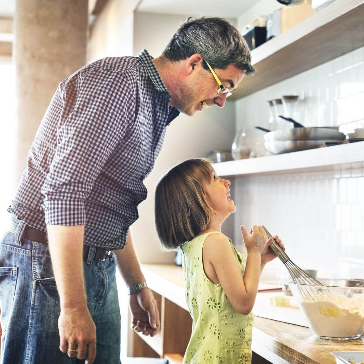 Man and grandaughter in kitchen